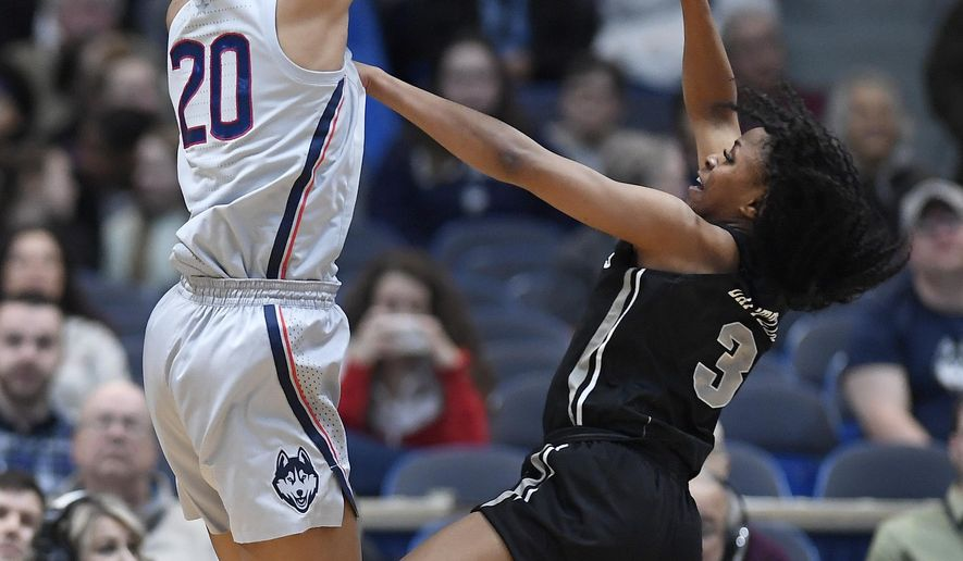 Connecticut's Olivia Nelson-Ododa blocks a shot attempt by Central Florida's Diamond Battles, right, during the first half of an NCAA college basketball game, Sunday, Jan. 27, 2019, in Hartford, Conn. (AP Photo/Jessica Hill)
