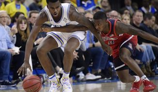 Arizona guard Justin Coleman, right, reaches for the ball against UCLA guard Kris Wilkes during the first half of an NCAA college basketball game Saturday, Jan. 26, 2019, in Los Angeles. (AP Photo/Mark J. Terrill)