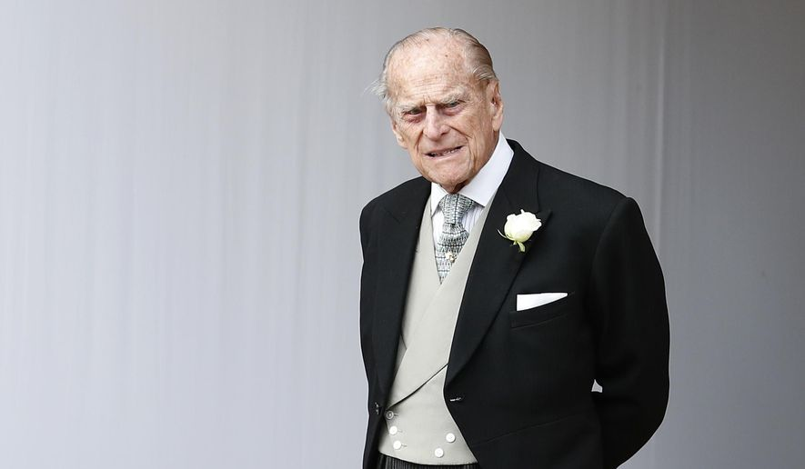 FILE - In this Friday, Oct. 12, 2018 file photo, Britain's Prince Philip waits for the bridal procession following the wedding of Princess Eugenie of York and Jack Brooksbank in St George's Chapel, Windsor Castle, near London, England. Prince Philip, the 97-year-old husband of Queen Elizabeth II, has apologized to a mother-of-two who was injured when the car she was riding in collided with a Land Rover he was driving on Jan. 17, 2019. (AP Photo/Alastair Grant, Pool)