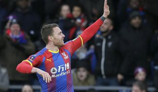 Crystal Palace's Connor Wickham celebrates after scoring the opening goal during an English FA Cup fourth round soccer match between Crystal Palace and Tottenham Hotspur at Selhurst Park in London, Sunday, Jan. 27, 2019. (AP Photo/Tim Ireland)