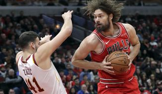 Chicago Bulls center Robin Lopez, right, drives against Cleveland Cavaliers center Ante Zizic during the first half of an NBA basketball game Sunday, Jan. 27, 2019, in Chicago. (AP Photo/Nam Y. Huh)