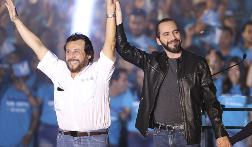 The presidential candidate for the Gran Alianza por la Unidad Nacional, GANA, Nayib Bukele, right, along with his running mate Felix Ulloa, raise their arms during a rally at the Plaza Gerardo Barrios, in San Salvador, El Salvador, on Saturday Jan. 26, 2019. Bukele leads in the polls as Salvadorans get ready to go to vote on Feb. 3. (AP Photo Salvador Melendez)