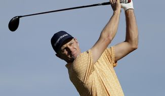 Justin Rose, of England, watches his tee shot on the second hole of the South Course at Torrey Pines Golf Course during the final round of the Farmers Insurance golf tournament Sunday, Jan. 27, 2019, in San Diego. (AP Photo/Gregory Bull)