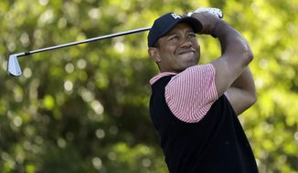 Tiger Woods hits his tee shot on the 11th hole of the South Course at Torrey Pines Golf Course during the final round of the Farmers Insurance golf tournament Sunday, Jan. 27, 2019, in San Diego. (AP Photo/Gregory Bull) ** FILE **