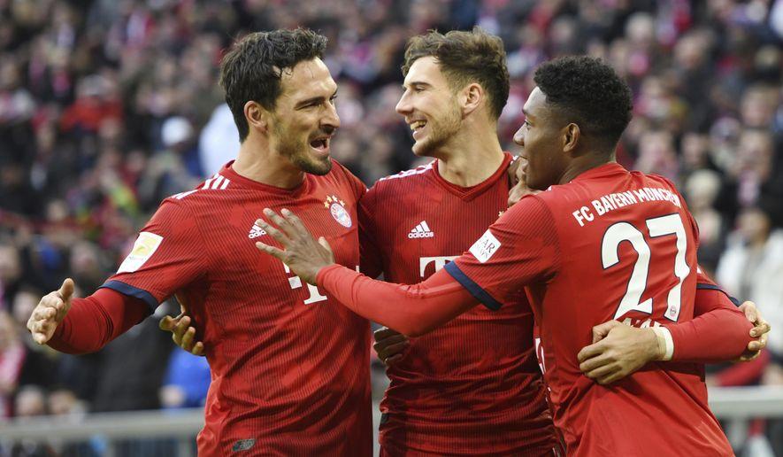Munich players celebrate their side's opening goal during a German Bundesliga soccer match between Bayern Munich and VfB Stuttgart in Munich, Germany, Sunday, Jan.27, 2019. (Tobias Hase/dpa via AP)