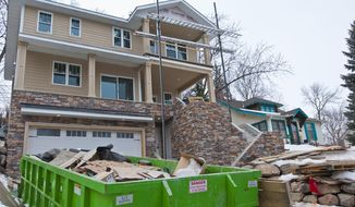 In this undated photo, debris pile up in front of a home construction site in Minneapolis. For decades in Minnesota, landfills for construction and demolition debris have not been required to use linings that stop toxic pollutants from seeping into groundwater. As the Minnesota Pollution Control Agency tells it, the waste wasn't considered to be an environmental risk when the landfill rules were first implemented in 1988. (Bill Kelley, MinnPost via AP)