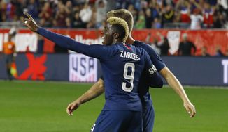 United States forward Gyasi Zardes (9) celebrates a goal against Panama by United States defender Walker Zimmerman, back right, during the second half of a men's international friendly soccer match Sunday, Jan. 27, 2019, in Phoenix. The United States defeated Panama 3-0. (AP Photo/Ross D. Franklin)
