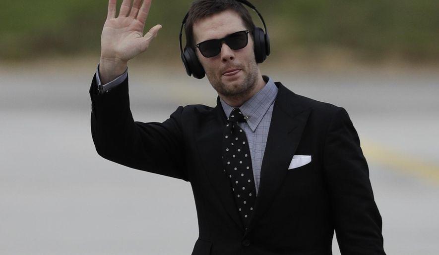 New England Patriots' Tom Brady arrives at the Hartsfield-Jackson Atlanta International Airport for the NFL Super Bowl 53 football game Sunday, Jan. 27, 2019, in Atlanta. (AP Photo/David J. Phillip)