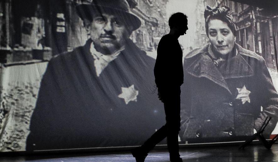 """An actor of the Romania's Jewish State Theatre rehearse the musical drama """"The Lights of the Ghetto"""" a mix of music and stories by Holocaust survivors in Bucharest, Romania, Saturday, Jan. 26, 2019, a day before the premiere on International Holocaust Remembrance Day. About 280,000 Romanian Jews and 11,000 Romanian Roma, or Gypsies, were deported and killed during WWII when Romania was ruled by a pro-nazi regime. (AP Photo/Vadim Ghirda)"""