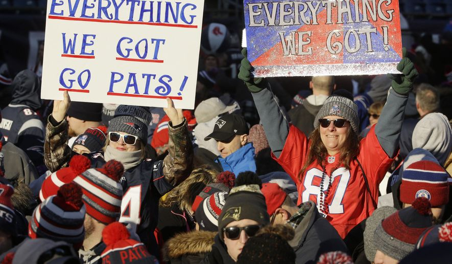 New England Patriots fans hold placards during an NFL football Super Bowl send-off rally for the team, Sunday, Jan. 27, 2019, in Foxborough, Mass. The Los Angeles Rams are to play the Patriots in Super Bowl 53 on Feb. 3, in Atlanta, Ga. (AP Photo/Steven Senne)