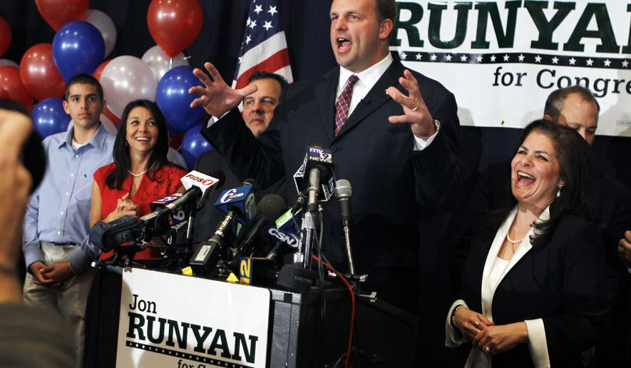 Wife Loretta Runyan, second left, and their son Jon Runyan Jr., left, look on as Republican Jon Runyan gestures  Tuesday, Nov. 2, 2010, in Mount Laurel, N.J., while celebrating at his victory party after defeating Democratic incumbent U.S. Rep. John Adler for New Jersey's 3rd Congressional District. Also looking on are Gov. Chris Christie, third left, and Assemblywoman Dawn Marie Addiego.(AP Photo/Mel Evans)
