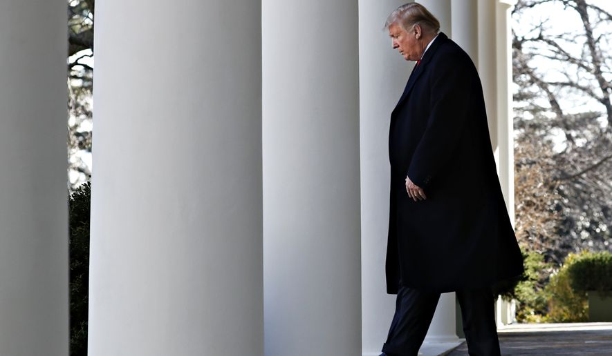 President Donald Trump walks through the colonnade of the White House on arrival to announce a deal to temporarily reopen the government, Friday, Jan. 25, 2019, from the Rose Garden of the White House in Washington. (AP Photo/Jacquelyn Martin)