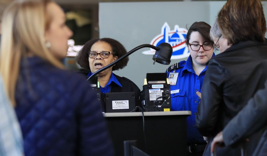Transportation Security Administration workers screen airline passengers at Reagan Washington National Airport in Washington, Monday, Jan. 28, 2019, as federal workers and government contract workers return to work ending the record 35-day partial federal shutdown which began before Christmas. (AP Photo/Manuel Balce Ceneta)