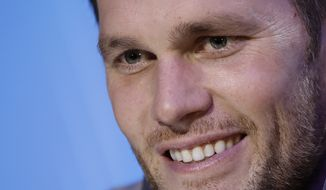 New England Patriots' Tom Brady answers questions during Opening Night for the NFL Super Bowl 53 football game Monday, Jan. 28, 2019, in Atlanta. (AP Photo/Matt Rourke)