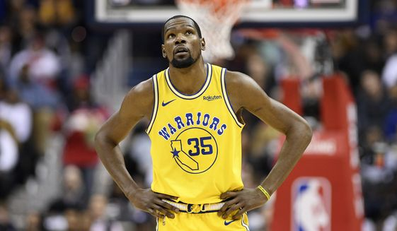 Golden State Warriors forward Kevin Durant (35) stands on the court during the first half of an NBA basketball game against the Washington Wizards, Thursday, Jan. 24, 2019, in Washington. (AP Photo/Nick Wass)