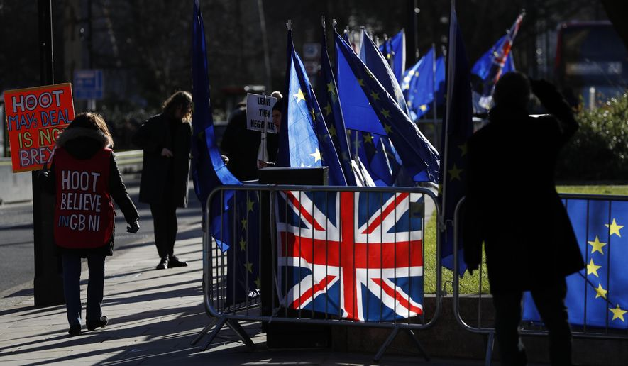 Pro- and anti-Brexit protesters demonstrate outside the Houses of Parliament in London, Monday, Jan. 28, 2019. British Prime Minister Theresa May faces another bruising week in Parliament as lawmakers plan to challenge her minority Conservative government for control of Brexit policy.(AP Photo/Alastair Grant)