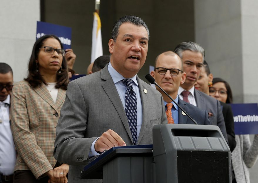 Secretary of State Alex Padilla discusses a proposed constitutional amendment to allow parolees to vote as the amendment's author, Assemblyman Kevin McCarty, D-Sacramento, right, looks on during a news conference at the Capitol, Monday Jan. 28, 2019, in Sacramento, Calif. (AP Photo/Rich Pedroncelli)