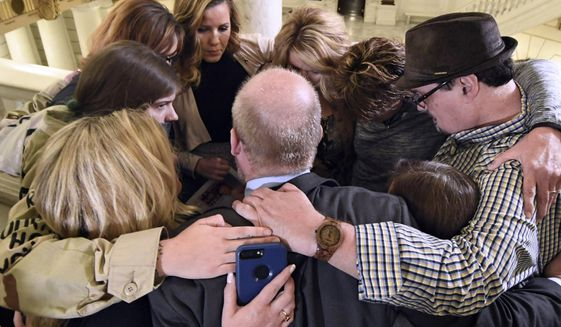 FILE- In this file photo from Oct. 17, 2018, survivors of child sexual abuse hug in the Pennsylvania Capitol in Harrisburg, Pa. while awaiting legislation to respond to a landmark state grand jury report on child sexual abuse in the Roman Catholic Church. Lawmakers have returned to the Pennsylvania Capitol for 2019 sessions, but they have yet to revisit a response to child sexual abuse scandals since the debate's late-night collapse that closed last year's final voting day. (AP Photo/Marc Levy, File)