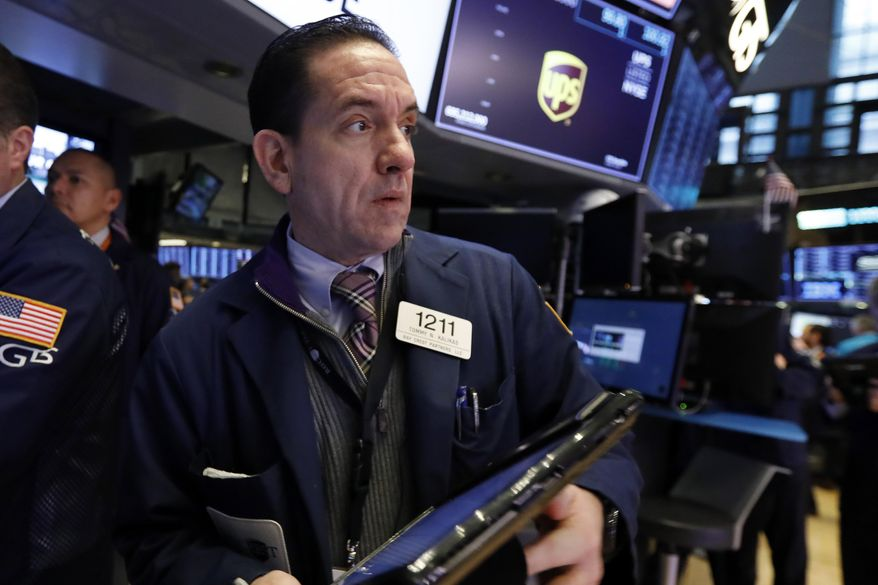 Trader Tommy Kalikas works on the floor of the New York Stock Exchange, Monday, Jan. 28, 2019. Stocks are opening broadly lower on Wall Street as traders worry about the impact on U.S. companies of a slowdown in China's economy. (AP Photo/Richard Drew)
