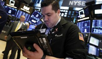 Trader Joseph Lawler works on the floor of the New York Stock Exchange, Monday, Jan. 28, 2019. Stocks are opening broadly lower on Wall Street as traders worry about the impact on U.S. companies of a slowdown in China's economy. (AP Photo/Richard Drew)