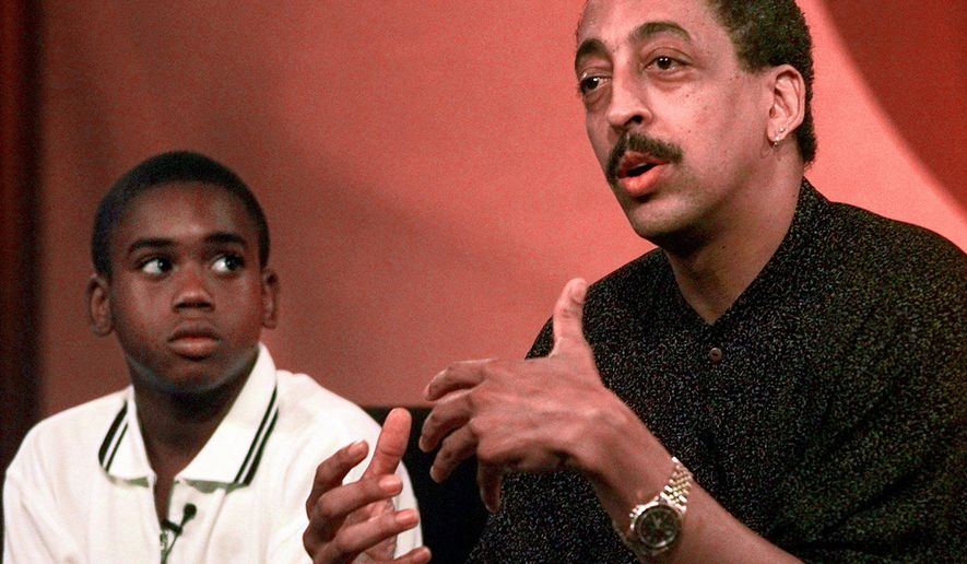 """FILE- In this July 15, 1997, file photo Gregory Hines, right, briefs the members of Television Critic's Association during the CBS' part of the TCA press tour as his co-star Brandon Hammond, who will play Hines' son in the new television series """"The Gregory Hines Show,"""" looks in Pasadena, Calif. The U.S. Postal Service is honoring entertainer Gregory Hines with a Black Heritage Series stamp. Acting chief postal inspector Gary Barksdale will host the first day of issue ceremony Monday, Jan. 28, 2019, at the Peter Norton Symphony Space in New York. (AP Photo/Kevork Djansezian, File)"""