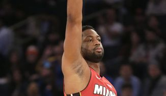 Miami Heat's Dwyane Wade reacts after sinking a three-point basket during the first half of the NBA basketball game against the New York Knicks, Sunday, Jan. 27, 2019, in New York. (AP Photo/Seth Wenig)
