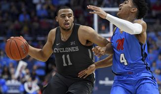 Iowa State guard Talen Horton-Tucker (11) drives the ball past Mississippi guard Breein Tyree (4) during the second half of an NCAA college basketball game in Oxford, Miss., Saturday, Jan. 26, 2019. Iowa State won 87-73. (AP Photo/Thomas Graning)