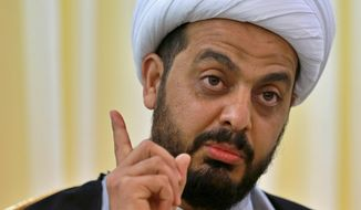 Qais al-Khazali, the leader of the militant Shiite group Asaib Ahl al-Haq, or League of the Righteous, speaks during an interview with The Associated Press in Baghdad, Iraq, Monday, Jan. 28, 2019. Al-Khazali said Monday that he expects a vote by the Iraqi parliament calling for the withdrawal of U.S. troops from the country within the next few months. Al-Khazali said there is no longer a justification for thousands of U.S. troops in the country after the Islamic State group has been defeated. (AP Photo/Khalid Mohammed)
