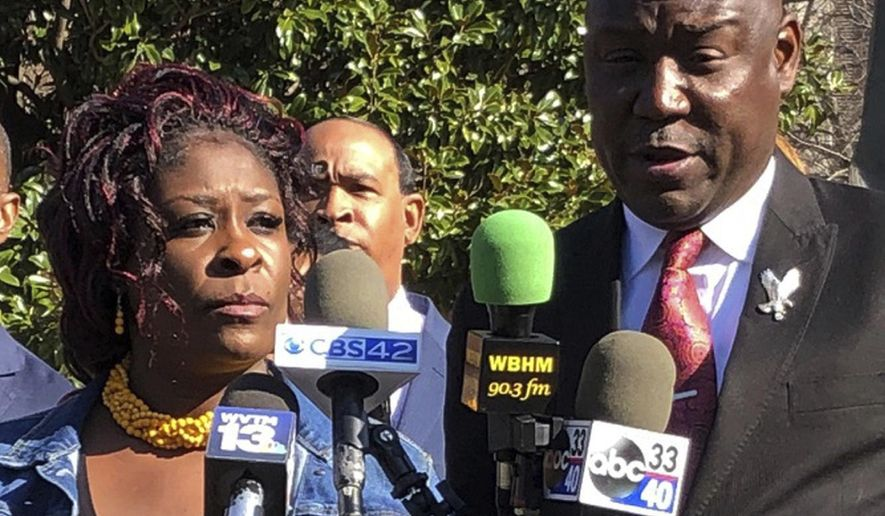 "FILE - In this Dec. 17, 2018, file photo, April Pipkins, the mother of Emantic ""EJ"" Bradford Jr., who was killed by police who apparently mistook him for the gunman in an Alabama mall shooting, and her family's lawyer, Ben Crump, hold a news conference in Birmingham, Ala. The family of Bradford asked the state attorney general Monday, Jan. 28, 2019, to meet with them and release video of the shooting. (AP Photo/Jay Reeves, File)"