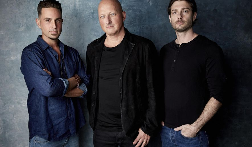 """FILE- In this Jan. 24, 2019, file photo Wade Robson, from left, director Dan Reed and James Safechuck pose for a portrait to promote the film """"Leaving Neverland"""" at the Salesforce Music Lodge during the Sundance Film Festival in Park City, Utah. Michael Jackson's family members said Monday, Jan. 28, that they are """"furious"""" that two men who accuse him of sexually abusing them as boys have received renewed attention because of a new documentary about them. The family released a statement denouncing """"Leaving Neverland,"""" a documentary film featuring Jackson accusers Robson and Safechuck. (Photo by Taylor Jewell/Invision/AP, File)"""