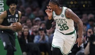 Boston Celtics guard Marcus Smart (36) taunts the Brooklyn Nets bench after hitting a three-point shot during the first quarter of an NBA basketball game in Boston, Monday, Jan. 28, 2019. (AP Photo/Charles Krupa)