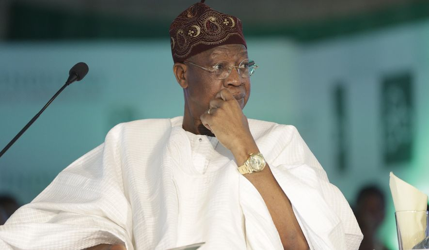 FILE - In this April 25, 2016, file photo, Nigeria Information Minister Lai Mohammed attends a town hall meeting in Lagos, Nigeria. Amid growing criticism, Nigeria's information minister denied on Monday, Jan. 28, 2019, that the president's recent suspension of the country's chief justice was related to the upcoming presidential elections. (AP Photo/Sunday Alamba, File)