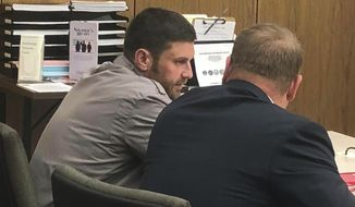 FILE - In this Oct. 3, 2018, file photo, Track Palin, left, talks with his lawyer Patrick Bergt before a hearing in Anchorage, Alaska. Palin, the elder son of former Republican vice presidential candidate Sarah Palin, has been released from custody at an Anchorage halfway house after his conviction for assaulting his father. (AP Photo/Rachel D'Oro, File)