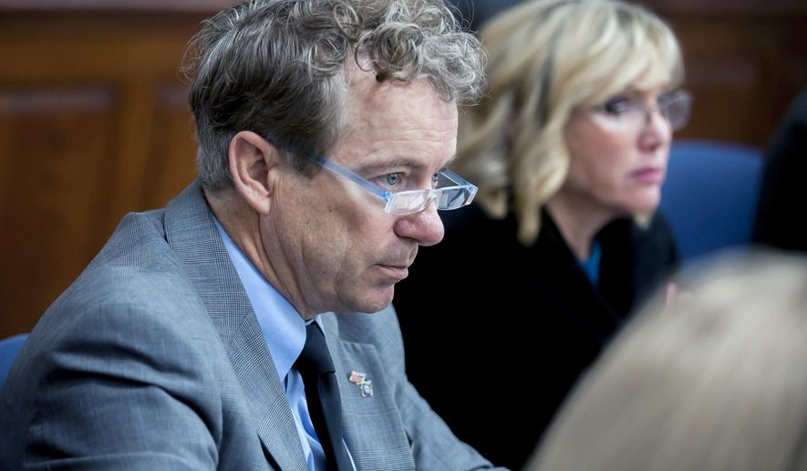 U.S. Sen. Rand Paul, left, R-Ky., and wife Kelley Paul listen to questions Monday, Jan. 28, 2019, during jury selection in a civil trial in Warren Circuit Court in Bowling Green, Ky. (Bac Totrong/Daily News via AP)