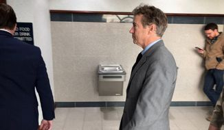 Sen. Rand Paul, center, appears during a break in jury selection for his civil trial in Bowling Green, Ky., Monday, Jan. 28, 2019. Jury selection began Monday in Paul's lawsuit against Rene Boucher for the 2017 attack that left the senator with multiple broken ribs. Paul is seeking up to $500,000 in compensatory damages and up to $1 million in punitive damages. (AP Photo/Bruce Schreiner)