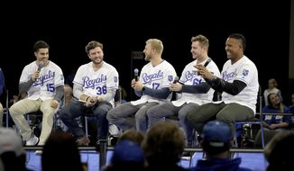 Kansas City Royals players Whit Merrifield (15), Cam Gallagher (36), Hunter Dozier (17), Ryan O'Hearn and Salvador Perez, right, answer questions from the crowd while appearing at the Royals Fanfest event Friday, Jan. 25, 2019, at Bartle Hall convention center in Kansas City, Mo. (AP Photo/Charlie Riedel)