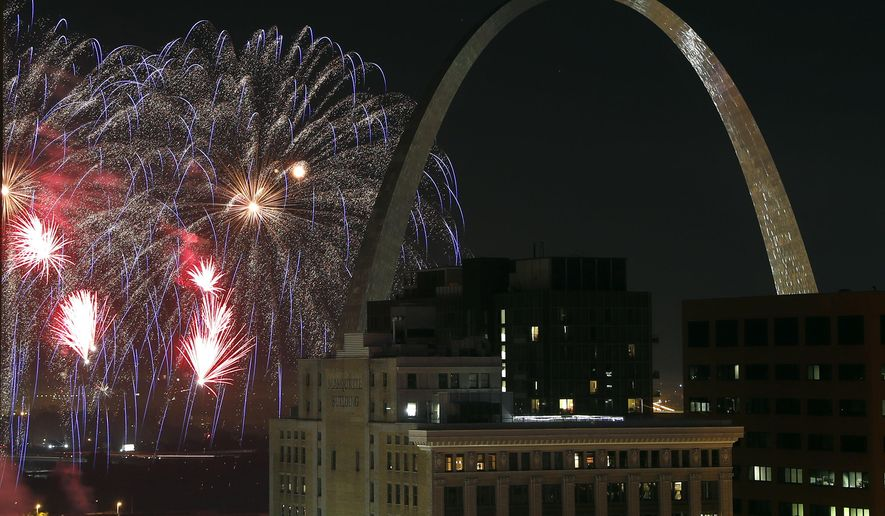 "FILE - In this July 4, 2018 file photo, fireworks illuminate the night sky near the Gateway Arch in St. Louis. A task force called Better Together on Monday, Jan. 28, 2019, revealed a plan that calls for a statewide vote seeking approval to merge St. Louis city and county. If approved, the new ""metropolitan city"" would have 1.3 million residents, instantly becoming the nation's 10th largest city. St. Louis currently ranks 62nd in population with just under 309,000 residents. (AP Photo/Jeff Roberson, File)"