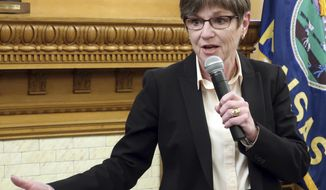 In this Jan. 24, 2019, photo, Kansas Gov. Laura Kelly answers questions from reporters during a news conference at the Statehouse in Topeka, Kansas. The Democratic governor is calling on lawmakers to avoid adjusting state tax laws but Republicans are planning to push ahead with a tax relief bill. (AP Photo/John Hanna)