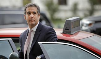 In this Sept. 19, 2017, file photo, Michael Cohen, President Donald Trump's personal attorney, steps out of a cab during his arrival on Capitol Hill in Washington. (AP Photo/Pablo Martinez Monsivais, File)