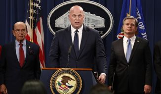 Acting Attorney General Matt Whitaker, center, with Commerce Secretary Wilbur Ross, left, and FBI Director Christopher Wray speak Monday, Jan. 28, 2019, at the Justice Department in Washington. The Justice Department unsealed criminal charges Monday against Chinese tech giant Huawei, two of its subsidiaries and a top executive, who are accused of misleading banks about the company's business and violating U.S. sanctions.(AP Photo/Jacquelyn Martin)