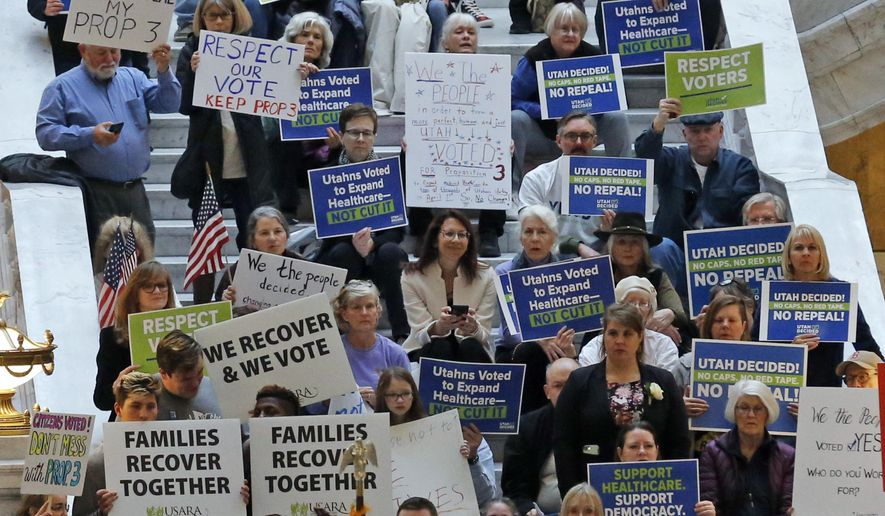 Supporters of a voter-approved measure to fully expand Medicaid gather at a rally to ask lawmakers not to change the law during the first day of the Utah Legislature, at the Utah State Capitol, Monday, Jan. 28, 2019, in Salt Lake City. (AP Photo/Rick Bowmer)