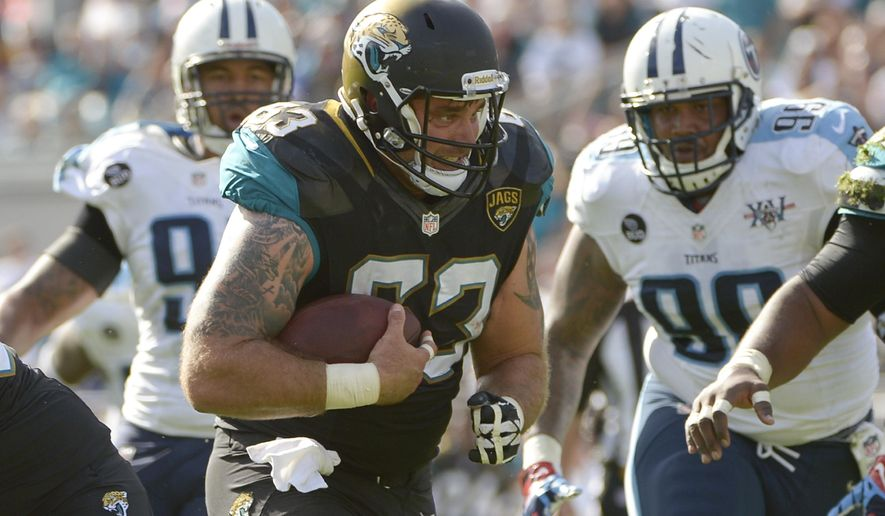 FILE - In this Dec. 22, 2013, file photo, Jacksonville Jaguars center Brad Meester (63) runs for a first down past Tennessee Titans defensive end Derrick Morgan, left, and defensive tackle Jurrell Casey (99) after catching pass during the first half of an NFL football game in Jacksonville, Fla. Some might argue the center is the most indispensable player on the roster, the player who mans the only position guaranteed to touch the ball on every play. He calls the shots for the line and gets the action going. (AP Photo/Phelan M. Ebenhack, File)