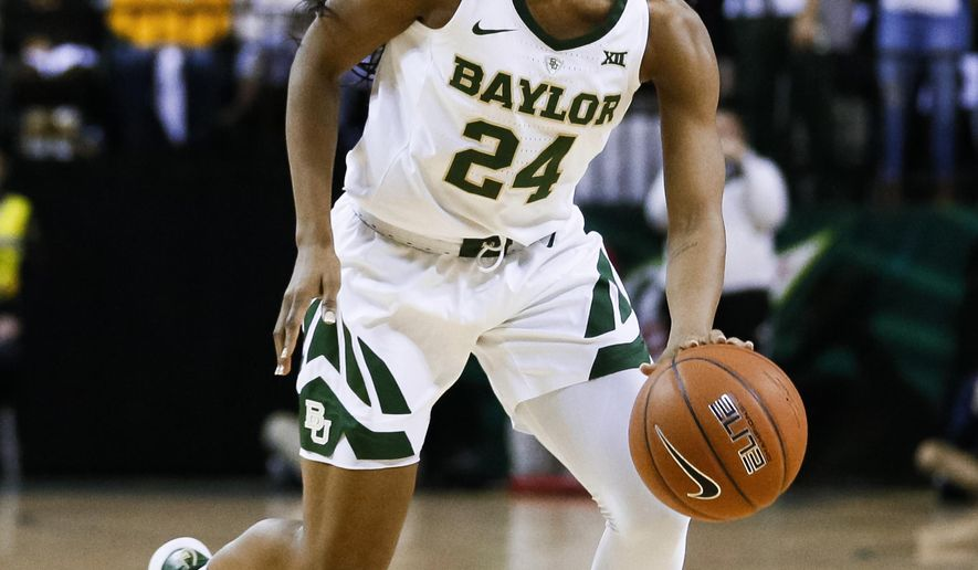 In this Jan. 3, 2019, photo, Baylor guard Chloe Jackson runs the offense during an NCAA college basketball game against Connecticut in Waco, Texas. Jackson took an unusual path to being the starting point guard for top-ranked Baylor and coach Kim Mulkey. (AP Photo/Ray Carlin)