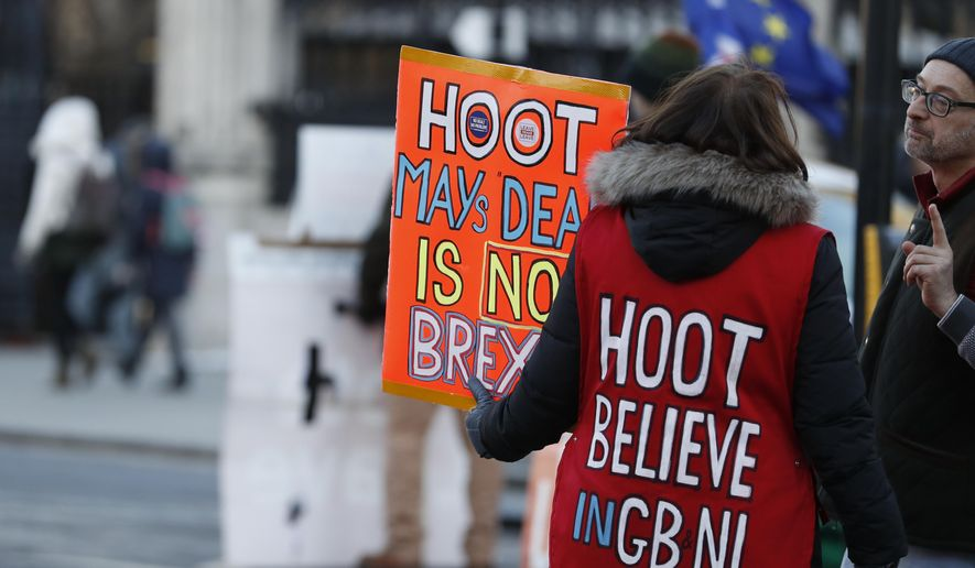 Pro Brexit demonstrators hold placards outside the Houses of Parliamnet in London, Monday, Jan. 28, 2019. Pro-Brexit British lawmakers were mounting a campaign Monday to rescue May's rejected European Union divorce deal in a parliamentary showdown this week. (AP Photo/Alastair Grant)