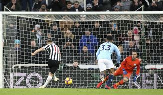 Newcastle United's Matt Ritchie scores during a English Premier League soccer match against Manchester City at St James' Park in Newcastle, England, Tuesday Jan. 29, 2019. (Richard Sellers/PA via AP)