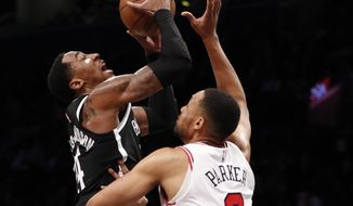 Chicago Bulls forward Jabari Parker (2) defends Brooklyn Nets forward Rondae Hollis-Jefferson (24) during the first half of an NBA basketball game Tuesday, Jan. 29, 2019, in New York. (AP Photo/Kathy Willens)