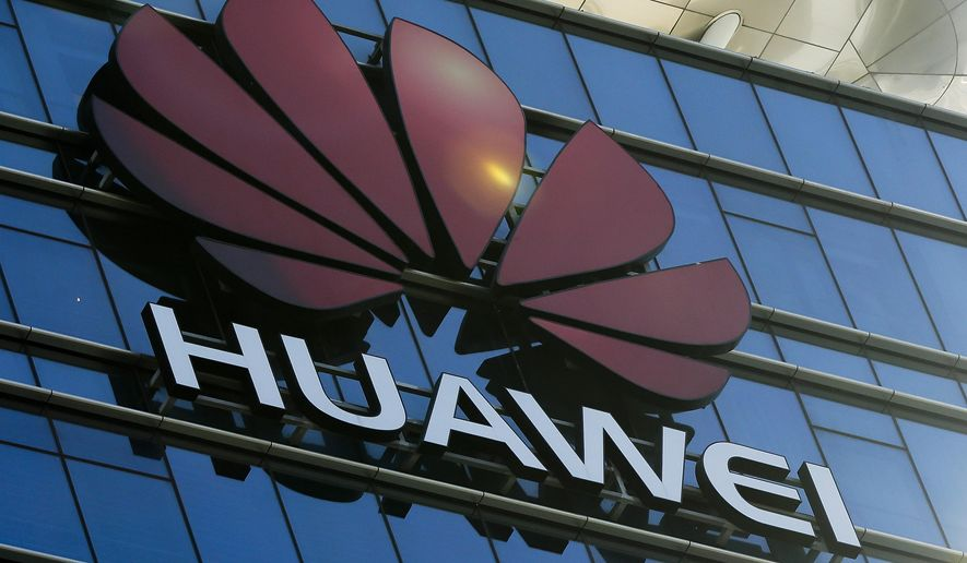 In perhaps its largest action, the Justice Department hit the Chinese telecommunications company Huawei with a slew of charges, including stealing trade secrets from T-Mobile. (Associated Press/File)