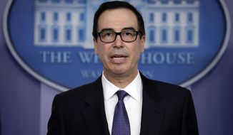 In this Jan. 28, 2019, photo, Treasury Secretary Steven Mnuchin speaks during a press briefing at the White House in Washington. Three senior House Democrats are demanding Mnuchin turn over documents that would show how his department decided to lift financial sanctions against three companies connected to Russian oligarch Oleg Deripaska. (AP Photo/ Evan Vucci)