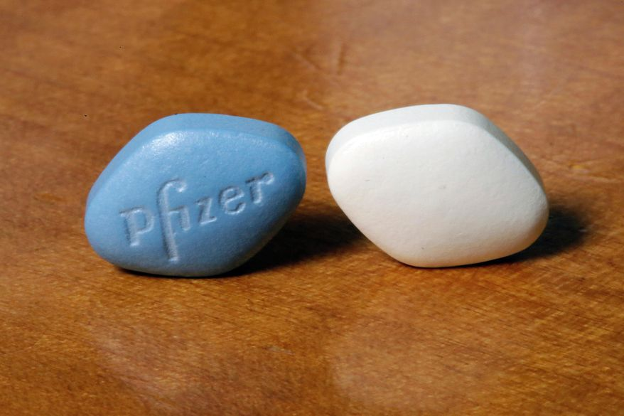 FILE- This Dec. 4, 2017, file photo shows a tablet of Pfizer's Viagra, left, and the company's generic version, sildenafil citrate, at Pfizer Inc., headquarters in New York. Pfizer Inc. reports earnings Tuesday, Jan. 29, 2019. (AP Photo/Richard Drew, File)