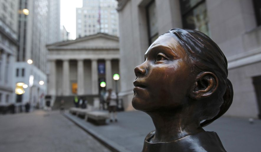 """FILE - In this Dec. 11, 2018 file photo, The Fearless Girl statue stands at its new location in front of the New York Stock Exchange.  Fearless Girl"""" statue creator Kristen Visbal is being sued by a group that says she failed to make a 9-foot (2.7-meter) bronze replica of Alexander Hamilton.  U.S. Coast Guard Academy Alumni Association's lawsuit says Kristen Visbal breached a $28,000 contract to create the statue.  (AP Photo/Mark Lennihan, File)"""